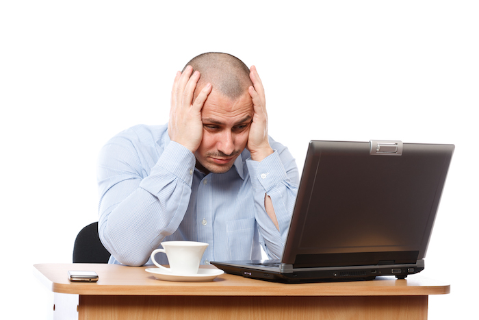 Stressed businessman at computer